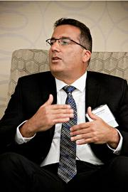 """Anthony Valente, CFO, of the Eliassen Group makes a point during the panel discussion at the Boston Business Journal's CFO Awards luncheon. The topic was """"The CFO as a Catalyst for Change: The Evolving Role of Finance as Leaders in Innovation."""""""
