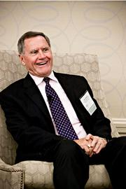 """Morris McInnes, associate dean at the Sawyer Business School at Suffolk University, enjoys a lighter moment as a panelist during the Boston Business Journal's CFO Awards luncheon. The topic was """"The CFO as a Catalyst for Change: The Evolving Role of Finance as Leaders in Innovation."""""""