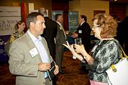 Judy Harrington of Boston Partners in Education appears to be making several points to McGladrey's Jeff Sheehan during the networking portion of the Boston Business Journal's CFO Awards luncheon.