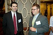 Wellington Management's Conor McEachern and Ryan Dolan of CFGI socialize during the networking portion of the Boston Business Journal's CFO Awards luncheon.