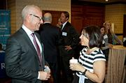 Tony Trequrtha of Enlighten Operational Excellence in conversation with Valerie McSorley of Avant Garde Events at the Boston Business Journal's CFO Awards luncheon.