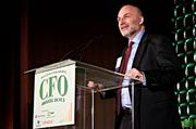 Robert LaRosa accepts his CFO of the Year award in the midsize private category at the Boston Business Journal's CFO Awards luncheon.