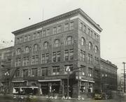 The Pacific Commercial Building in Seattle's Pioneer Square originally was only two stories tall. The building is shown after three floors were added in 1905.