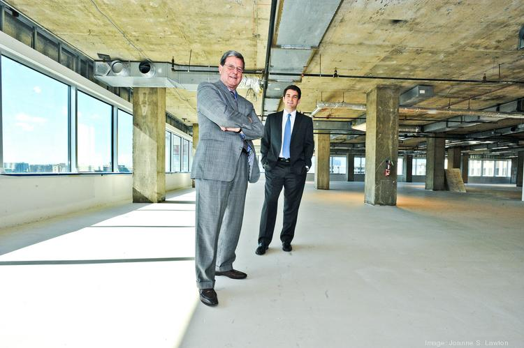Avison Young broker Dave Millard, left, with colleague Nicholas Gregorios, at Presidential Tower in Crystal City, which Beacon Capital is renovating to attract new tenants. The full 345,000-square-foot building is available.