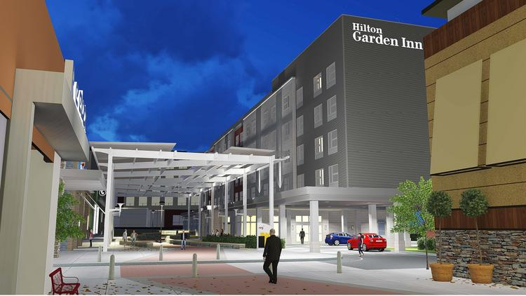 A 136-room Hilton Garden Inn will open at Patriot Place, the shopping and entertainment hub adjacent to Gillette Stadium, by next fall.