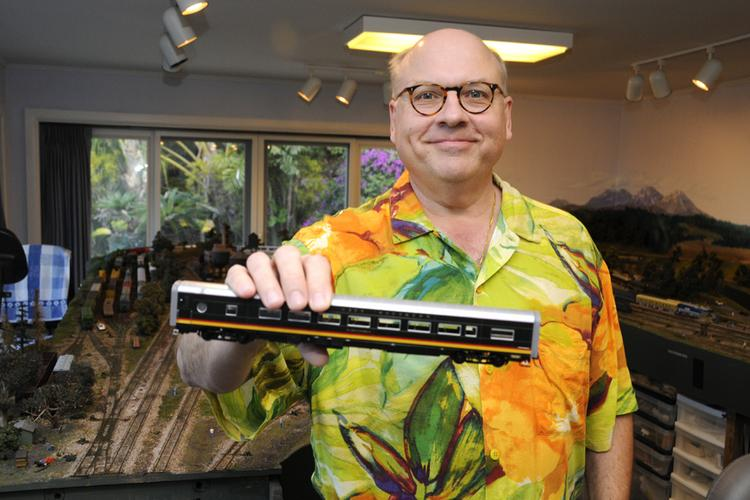 """Chuck Sted, who retired from his post as CEO and president of Hawaii Pacific Health in March, is seen in """"the train room"""" at his Honolulu home."""
