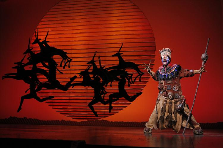 "Buyi Zama plays Rafiki in the musical production ""Disney's The Lion King."""