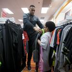 Milwaukee Bucks players go shopping with some special guests: Slideshow