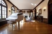 The spacious living room has room for a piano.