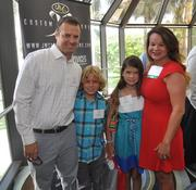 Honoree Nicole Heran, right, takes a picture with her family.