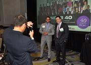 Jeremy Katzman of Miami Children's Hospital Foundation taking a picture of honorees Ricky Patel and Luke Freeman.