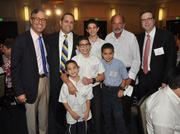 From left: Rickard Pollack; honoree Joseph Saka and four of his nine children; Sandy Saka, Joseph's father; and Barry Brant of Berkowitz Pollack Brant Advisors