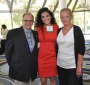 Rick Russell, honoree Ariela Wagner of SunRay Construction Solutions and Rita Harting-Smith.