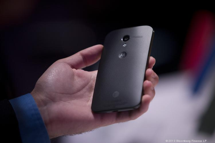 An attendee inspects the Motorola Mobility Moto X phone during a launch event.