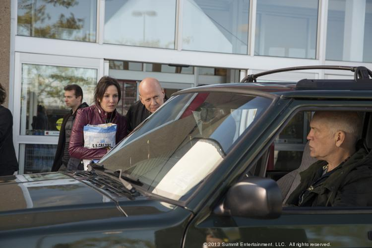 "Mary Louise Parker, Bruce Willis and John Malkovich in a scene from ""Red 2."""