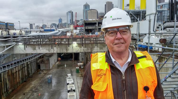 Seattle Tunnel Partners Project Manager Chris Dixon, with the south entrance of the downtown tunnel behind him.