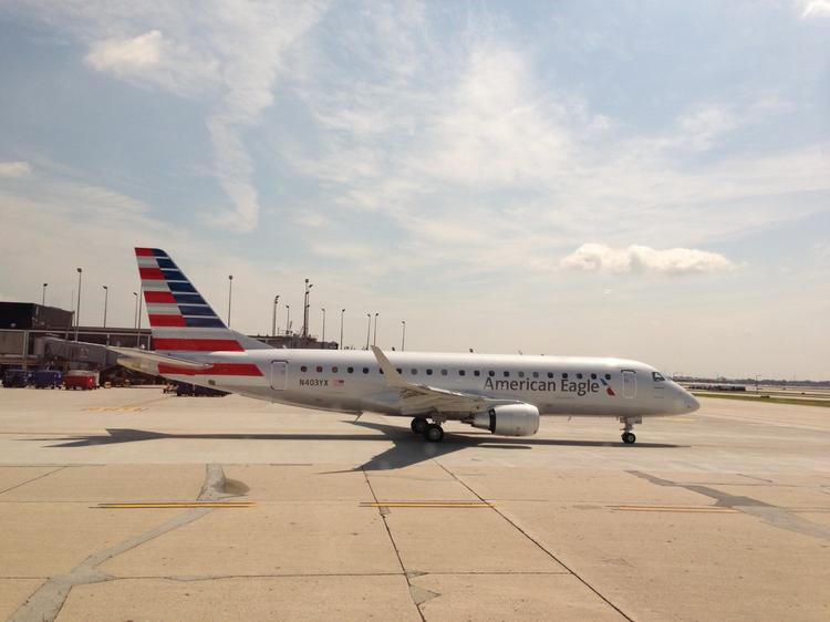 Two of American Airlines' three new Embraer 175 regional jets pass by each other Friday afternoon at Chicago O'Hare International Airport in Chicago. This is the view of one of the Embraer's from inside the other.
