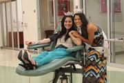 From left, Miss Oahu Brittni Woodward donates blood at the Blood Bank of Hawaii's Young Street Donor Center, wiht support from Miss Hawaii Crystal Lee. Woodward, Lee and other Miss Hawaii contestants support the Blood Bank of Hawaii by donating blood and asking friends and family to participate