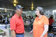 David Kamimura, left, chief lending officer for Finance Factors, and Lyn Moku, director of Lanakila Meals on Wheels, coordinate breakfast orders at the Finance Factors' 18th-annual charity breakfast held at outside the company's Bishop Street building. This years' proceeds will go to Lanakila Meals on Wheels.