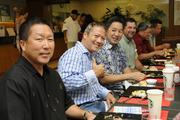 From left, Scott Hayashi and Eric Ogata of Hawaii Pacific University and attorneys Alan Lau and Chris Muzzi at a VIP breakfast seating for Finance Factors' 18th-annual charity breakfast held at the company's Bishop Street building. This year's proceeds will go to Lanakila Meals on Wheels.