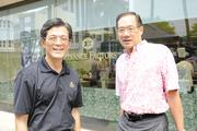 Russel Lau, left, vice chairman and CEO of Finance Factors Ltd., and Buzz Wo, principal  of CKW Financial, pose for a photo during the Finance Factors 18th-annunal charity breakfast. This year's proceeds will go to Lanakila Meals on Wheels.