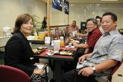 From left, Malia Siu, vice president and Realtor at Eighteen Properties; Jeff Mau, senior asset manager at Kamehameha Schools; and Eric Tsugawa,  a partner at Tsugawa Biehl Lau & Muzzi Law firm, at a VIP breakfast seating at  Finance Factors' 18th-annual charity breakfast held at the company's Bishop Street building. This year's proceeds will go to Lanakila Meals on Wheels.