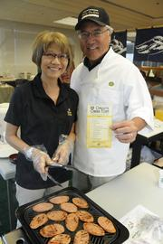 Finance Factors President and COO Steven Teruya, right, and his wife, Cynthia, cook up some Portuguese sausage for the VIP omelet  station at the company's 18th-annual charity breakfast inside the Finance Factors building on Bishop Street. This year's proceeds will go to Lanakila Meals on Wheels.