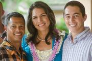 """From left, Rodney Sanchez, events coordinator for Habilitat, U.S. Rep. Tulsi Gabbard, D-Hawaii,  and Kirk Markam of Habilitat pose for a photo at Habilitat's Kaneohe facility. Habilitat was awarded $1,500 for being a finalist in Toshiba's nationwide """"Helping the Helpers"""" nonprofit video contest."""