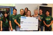 From left, in green shirts, HWMG Chief Financial Officer Laurie Jim, Assistant Vice President Cristofer Baptiste, President Arnie Baptiste, Executive Vice President Jay Lenci, and Assistant Vice President Jason Baptiste, present HWMG's 2013 donation to Kim Bartenstein, Megan Young and Sherri Rolf of the Hawaii Foodbank. HWMG has donated $217,159 and 87,500 pounds of food to the Hawaii Foodbank over the past 12 years.