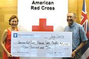 Coralie Matayoshi, left, CEO of the American Red Cross, Hawaii State Chapter, accepts a check for $15,000 from Tyler Tokioka, president of the Island Insurance Foundation, to help support the nonprofits programs and services.