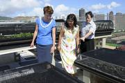 From left, Bettina Mehnert, principal and COO for Architects Hawaii Ltd.; Connie Mitchell, executive director for the Institute for Human Services, and Marc Alexander, director of community relations and development for the Institute for Human Services, get a glimpse of the nonprofit's $500,000 rooftop training and education center at its Honolulu service shelter. Architects Hawaii built the garden as part of its pro bono program. Numerous donors supported the project, which started in 2009 when IHS began looking at urban and sustainable agriculture.
