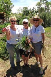 The Windermere Valley Isle Properties team, from left, Lisa Mascaro, Sherry Llanes and Virginia Pierce, volunteer to help The Maui Farm with maintenance projects for their real estate company's annual community service day. The Maui Farm is a nonprofit organization providing farm-based, family-centered programs that teach essential life skills for self-sufficient living.