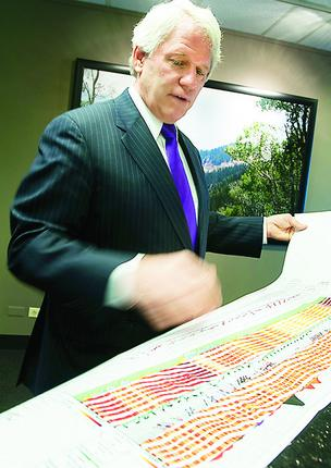 Scott Hall, CEO of Black Diamond Minerals, displays an open hole log that indicates microfractures used in oil production.