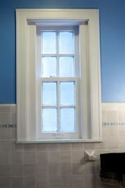 Here is a window in a bathroom on the first floor.