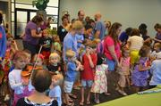 Children stand in line to play one of a handful of instruments.