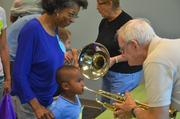 """Children had an opportunity to play musical instruments as part of the """"Grow Up Great"""" initiative funded by PNC Bank."""
