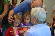 This little girl received a brief lesson in playing the flute.