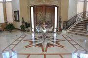 The front foyer of the house, with Italian stone lining the floor.