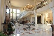 The staircase and chandelier in the foyer.