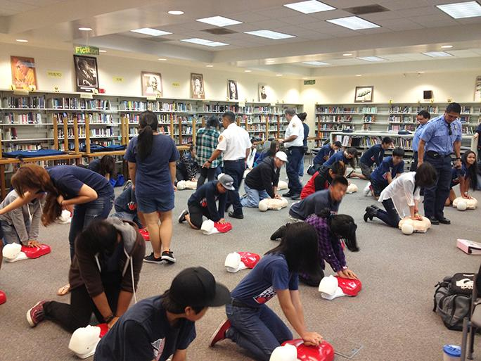 Hands only CPR training at Keaau High School Library.