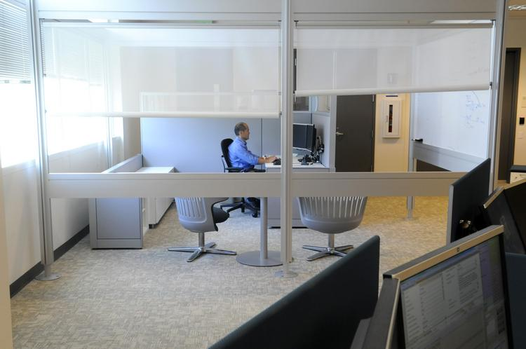 Gary Baba, contact center leader at the Sutter Health Shared Services Center, works at a semi-private workstation.