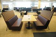 Employee workspaces at the new Sutter Shared Services Center are grouped by function like a series of neighborhoods to create a sense of community. There are no cubicle walls or private offices. This is a meeting space for employees.