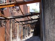 An alley behind the burned-out Frager's hardware store. While the facade remains, there's very little left of the interior. Raze permit applications have been filed for the two buildings that comprise Frager's.