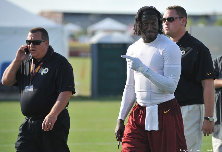 Two of the Washington Business Journal's three most-read stories this year involved Redskins' quarterback Robert Griffin III and his new home in Loudoun County.