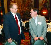 Michael Dyrwal, left, of Adams Mortgage Capital and David McMullen of Franjo Construction.