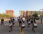 Members of The Fightin' Texas Aggie Band lead a procession to Tuesday night's public remembrance of George P. Mitchell