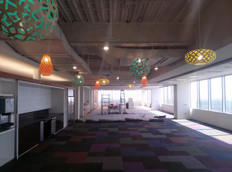 The space is still in progress, but the company plans to move in to the LEED-certified space in a couple of weeks.  Click through the slideshow to see more renderings and photos of the new space.