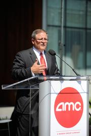 AMC Entertainment Inc. CEO Gerry Lopez thanks Gov. Sam Brownback and Leawood Mayor Peggy Dunn during the Theatre Support Center's grand opening.