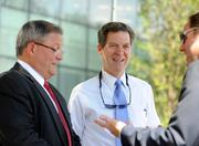 Kansas Gov. Sam Brownback visited AMC's new headquarters to tout state tax policies that he says retained AMC's more than 400 jobs and is helping secure Kansas City's economy.
