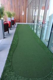 An open air break room sports a putting green in addition to ping pong tables at AMC's new headquarters in Leawood, Kan.